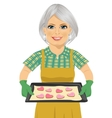 senior woman holding baking tray with cookies vector image vector image