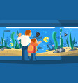 dad with son in oceanarium vector image