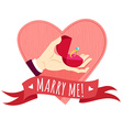 Hand holding wedding ring in a box Heart shape vector image