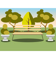 bench under a tree in the park vector image