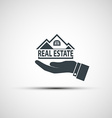 Hand holds the house vector image vector image