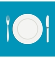 Knife and a fork near the empty plate on a white vector image
