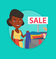 young woman choosing clothes in shop on sale vector image