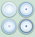 set of white porcelain plate with blue ornament vector image vector image