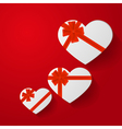 Heart-shaped gifts with red bow on red background vector image