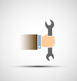 Hand holding a wrench vector image