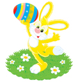 easter bunny and painted egg vector image vector image