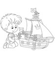 boy playing a toy ship vector image vector image