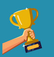 hand holding a trophy vector image