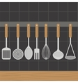 Kitchen utensils weighs on a wall in the kitchen vector image