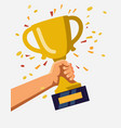 gold trophy hold in hand vector image
