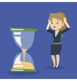 Desperate business woman looking at hourglass vector image