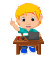 kid boy using the computer cartoon vector image
