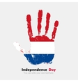 Handprint with Flag of the Netherlands in grunge vector image