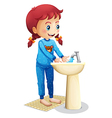 A cute little girl washing her face vector image vector image