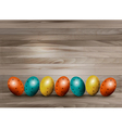 Holiday Easter eggs on wooden background vector image