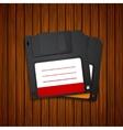 modern diskette on wooden background vector image