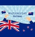 waitangi day hand holds a new zealand flag vector image