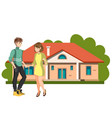 couple standing outside new home vector image
