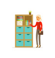 Senior woman standing in the office over folder vector image