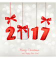 Christmas background with a 2017 and a gift box vector image