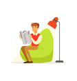 businessman sitting in green armchair and reading vector image