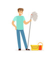 young smiling man cleaning the floor with a mop vector image