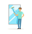 young smiling man washing window house husband vector image