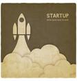startup concept with rocket vintage background vector image