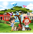 Girls playing with animals outside vector image