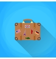 travel suitcase with funky stickers vector image
