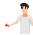 boy holding spinner cute cartoon character vector image