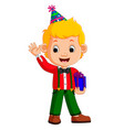 boy holding birthday gifts vector image