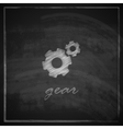 vintage with a gear icon on blackboard background vector image