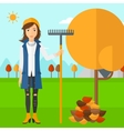 Woman with rake standing near tree and heap of vector image