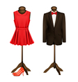 A suit and a formal dress on mannequins with red vector image vector image