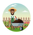 african farmer man straw hat wheelbarrow earth vector image