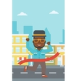 Businessman crossing finish line vector image
