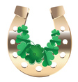 Gold horseshoe with clover vector image
