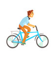 cyclist male in casual clothes riding a bike vector image