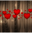 Red hearts on brown wooden background vector image