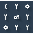 Gear and wrench white icons set over blue vector image