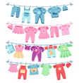 baby clothes drying on clothesline vector image