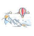 balloon flying in sky above mountains vector image
