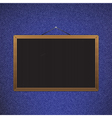 Black chalkboard with brown corners over jeans vector image vector image