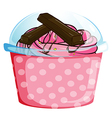 A sweet cupcake inside a sealed cup vector image vector image