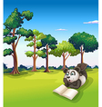 A panda lying at the grass while reading a book vector image vector image