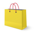 ywllow paper shopping bag with red rope handles vector image