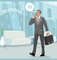 happy businessman in restroom at work vector image