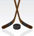 hockey puck and stick vector image vector image